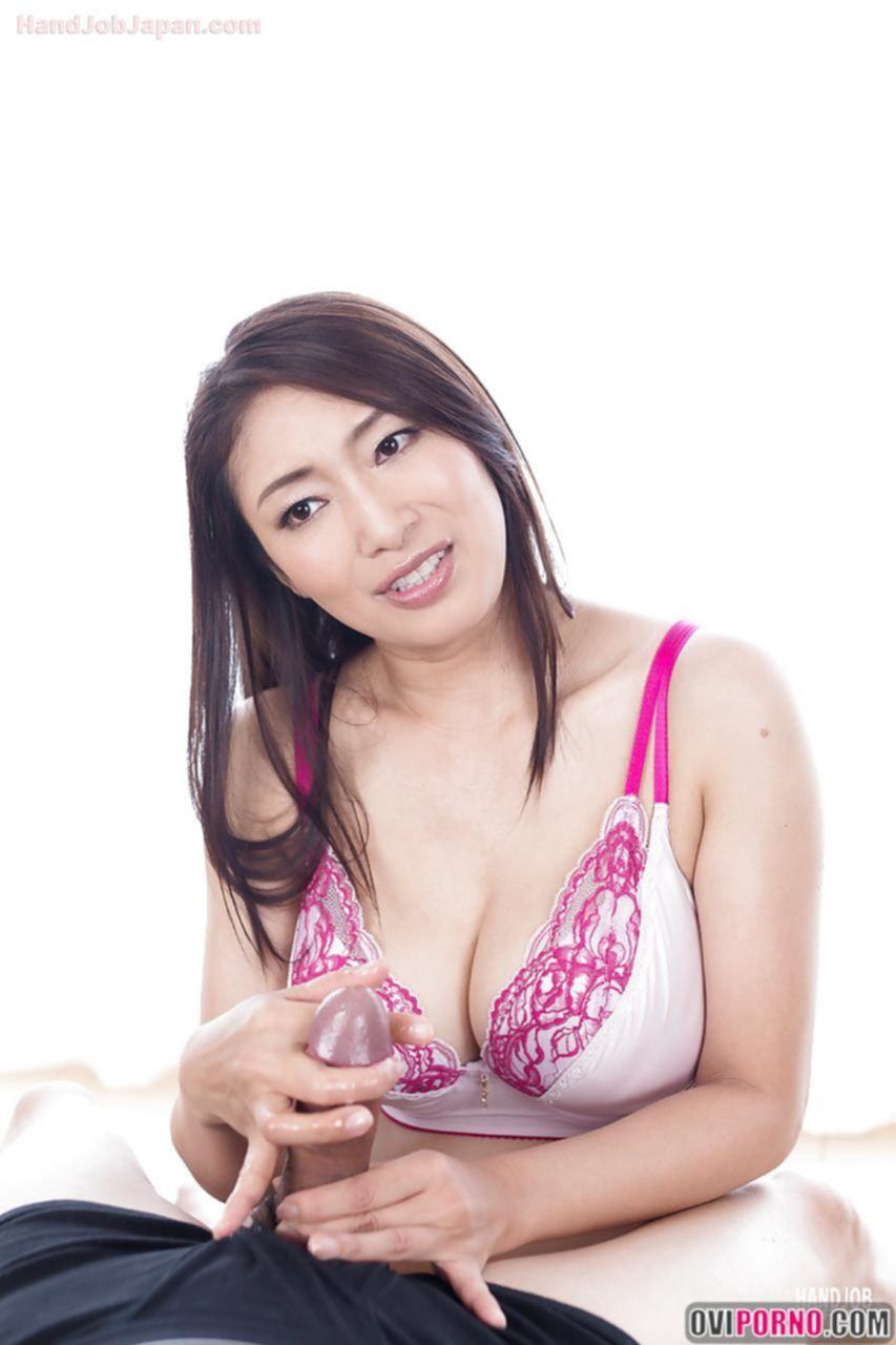 Азиатка дрочит член